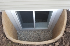 Tan Rockwell Window Well - Process of Installing an Egress Window in a Basement in Green Bay, WI